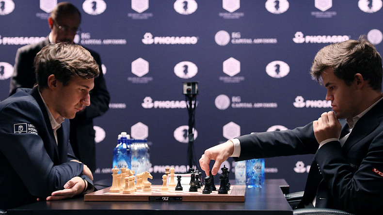 Magnus Carlsen checkmates Russia's Sergey Karjakin to win nail-biting world chess playoff