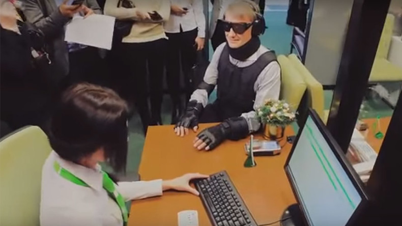 Russian bank chief causes Twitter frenzy after showing up to check service in 'disabled costume'
