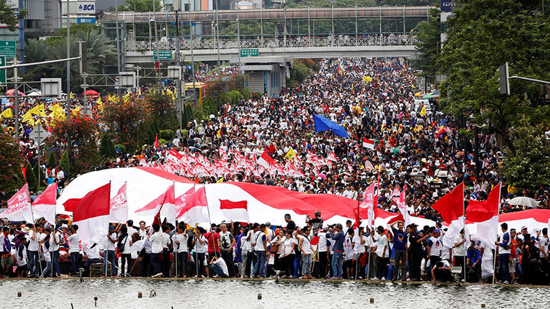 Tens of thousands march in Indonesia to support first Christian governor after 'blasphemy' protests