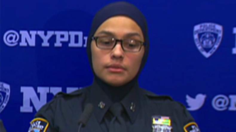 'I will cut your throat': Muslim NYPD officer in hijab and son attacked