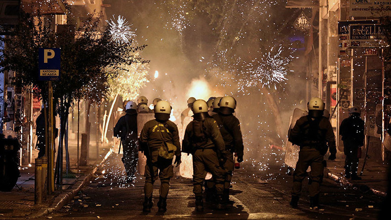 Athens' protesters mark anniversary of police student-slaying by going after 'EU financial elite'