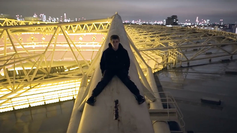 Heart-stopping video shows fearless daredevils scale stadium roof without harness