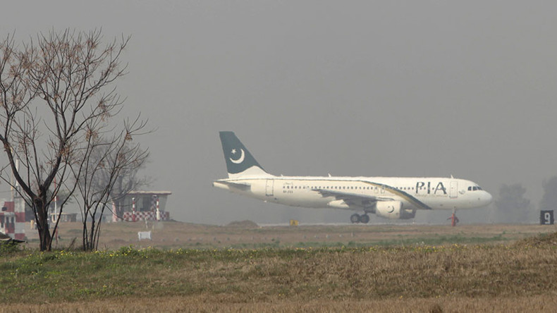 Sacrifice for safety? Pakistani airline staff behead goat on runway before flight (GRAPHIC PHOTO)