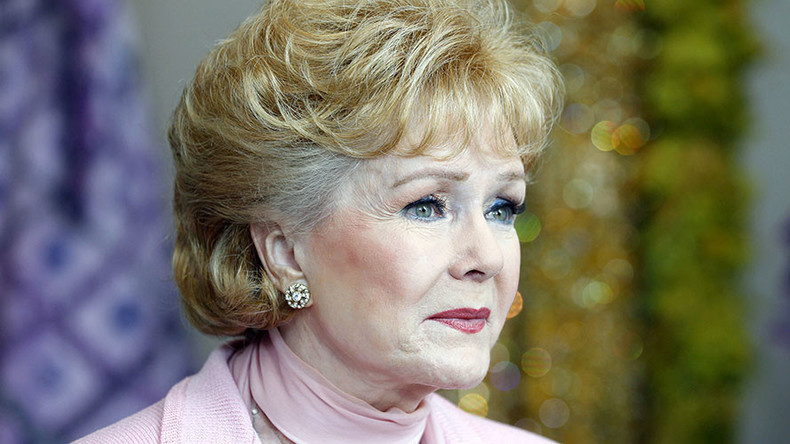 Singin' in the Rain star Debbie Reynolds, mother of Carrie Fisher, dies at 84