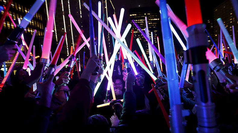 Star Wars fans honor Carrie Fisher with lightsaber vigils