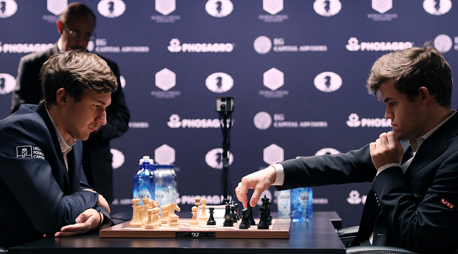 Magnus Carlsen checkmates Russia's Sergey Karjakin to win nail-biting world chess playoff