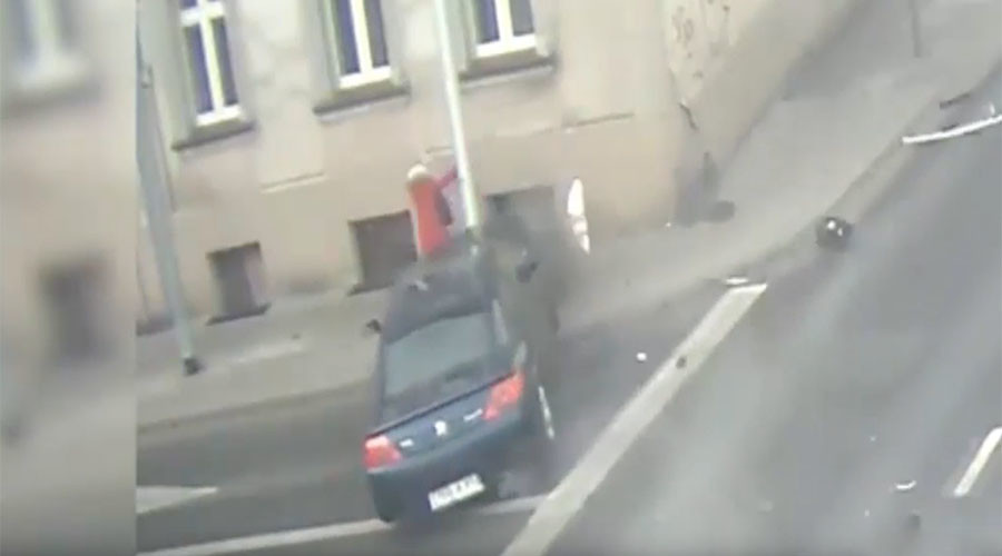 Nerve-shredding footage shows lamp post save woman from runaway car (VIDEO)
