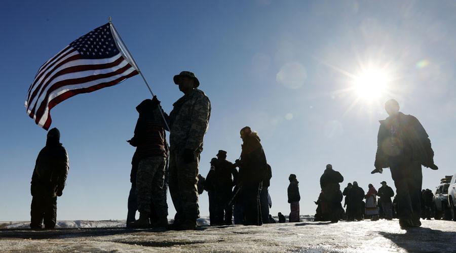 After Dakota Access Pipeline victory, veterans headed to Flint