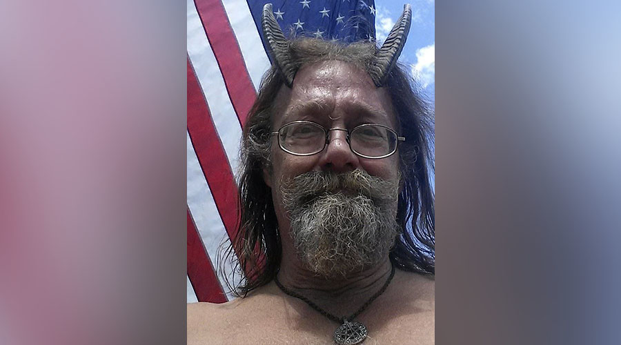 Pagan priest wins right to wear horns on photo ID (PHOTOS)