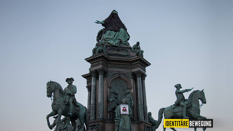 Austrian far-right group covers queen's statue with veil in anti-Islam protest