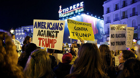 Demonstrators hold up signs during a protest against U.S. President-elect Donald © Paul Hanna