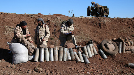 Rebel fighters stand near empty shells in Jubata al-Khashab, Quneitra province, Syria November 26, 2016 © Alaa Al-Faqir
