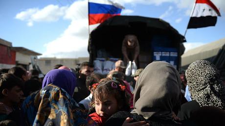 FILE PHOTO. Residents of Kaukab, Syria during the distribution of Russian humanitarian aid. ©Maksim Blinov