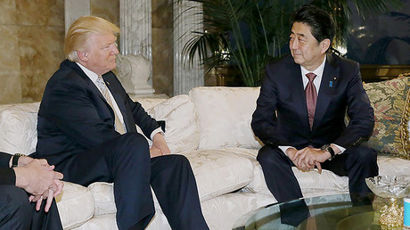 This handout picture, released by Japan's Cabinet Secretariat on November 18, 2016 shows Japanese Prime Minister Shinzo Abe (R) in a meeting with US president-elect Donald Trump (L) in New York © HO