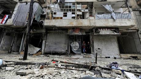 Boys stand amid the damage in the government-held al-Shaar neighborhood of Aleppo, Syria December 13, 2016. © Omar Sanadiki