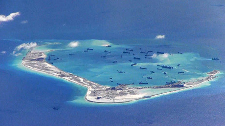 Chinese dredging vessels are purportedly seen in the waters around Mischief Reef in the disputed Spratly Islands in the South China Sea. File photo. © U.S. Navy