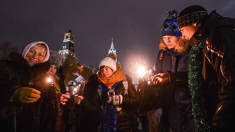 City residents and visitors to Moscow celebrate New Year's Eve on Vasilyevsky Spusk, Moscow. © Eugene Odinokov