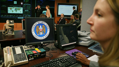 A worker at the National Security Agency (NSA) sits at her computer terminal in the Threat Operations Center. File photo. © Jason Reed