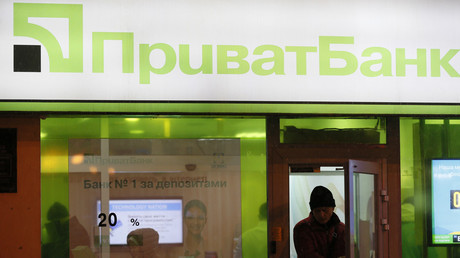 A man leaves a branch of Privatbank © Valentyn Ogirenko