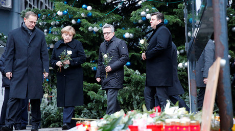 Berlin mayor Michael Mueller, German Chancellor Angela Merkel and Interior Minister Thomas de Maiziere prepare to lay flowers at the Christmas market in Berlin, Germany, December 20, 2016, where a truck ploughed into the crowd on Monday © Hannibal Hanschke