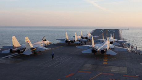 Chinese J-15 fighter jets waiting on the deck of the Liaoning aircraft carrier during military drills in the Bohai Sea. © STR