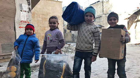 FILE PHOTO. Children receive the first humanitarian aid in eastern Aleppo. © Mikhail Alaeddin