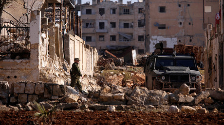 A Russian soldier walks to a military vehicle in  Hanono housing district in Aleppo, Syria  © Omar Sanadiki