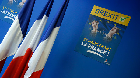 """FILE PHOTO: A poster which reads """"Brexit, And now France"""" is seen near French flags before a news conference at the France's far-right National Front political party headquarters in Nanterre near Paris after Britain's referendum vote to leave the European Union, June 24, 2016 © Jacky Naegelen"""