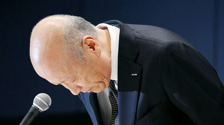 Tadashi Ishii, president of Japan's top advertising agency Dentsu Inc, bows during a news conference in Tokyo, Japan, in this photo taken by Kyodo December 28, 2016. © Kyodo