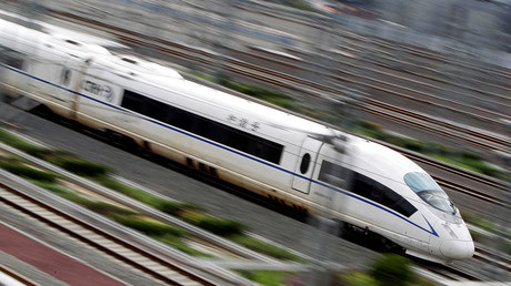 A China Railway High-speed bullet train runs towards Beijing South Railway Station © Jason Lee