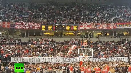 "Serbian fans holding a banner, reading ""May heaven hear the song of this 20,000-strong choir!"" during the Crvena Zvezda-CSKA Euroleague basketball match / RT video still"