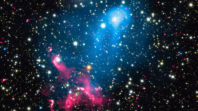 Colliding galaxy clusters meet supermassive black hole to create cosmic particle accelerator