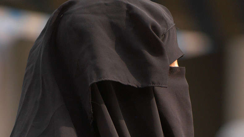 'Embarrassing' anti-burqa posters add fuel to fire in Swiss naturalization debate
