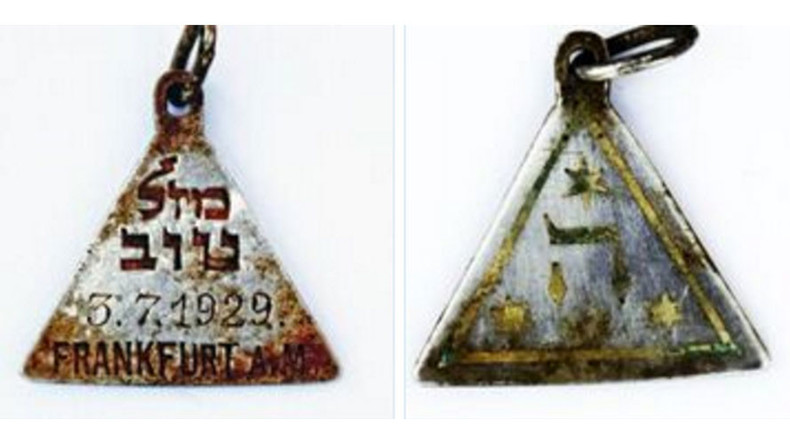 Pendant linked to Anne Frank found at Nazi extermination camp