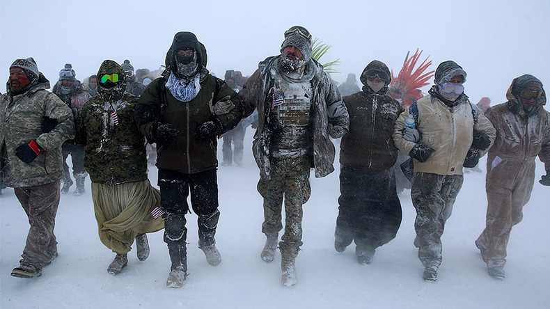 North Dakota seeks to outlaw masked rallies, allow driving over protesters