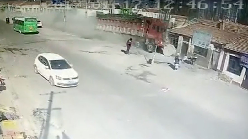 Dramatic CCTV footage shows moment speeding truck crashes into row of houses, killing 5