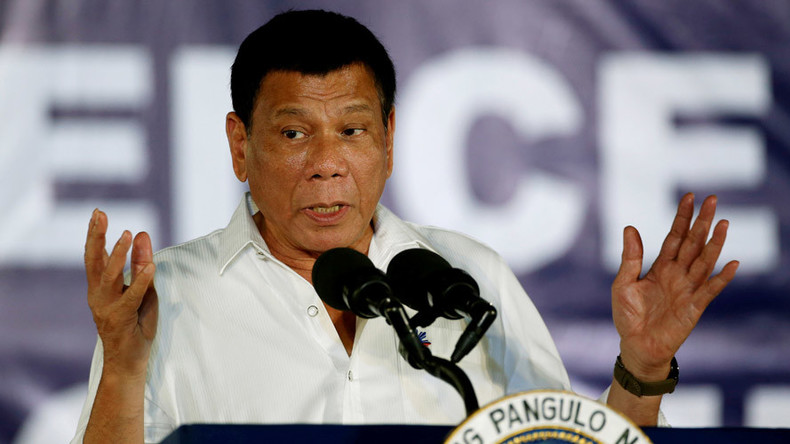 Try meth before criticizing war on drugs, Duterte tells priests the day Pope blesses Philippines