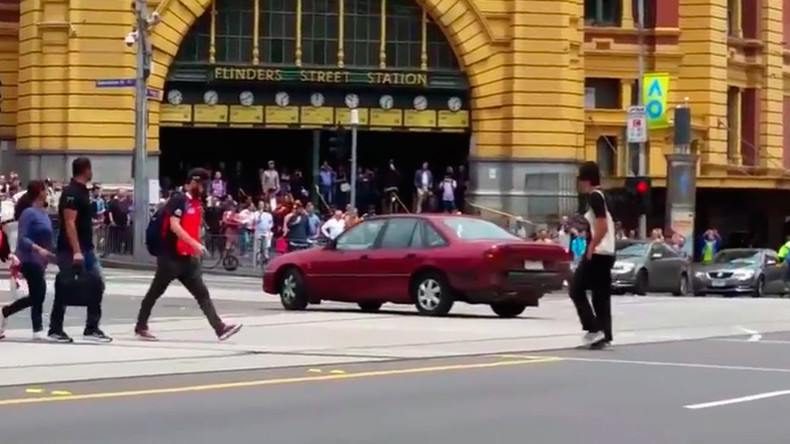 Car 'driving erratically' before smashing into Melbourne crowd caught on camera (VIDEOS)