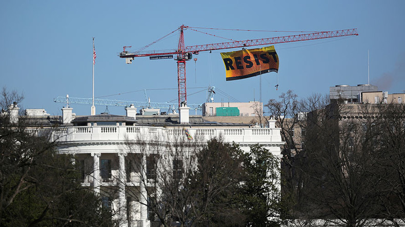 Protesters climb crane at DC construction site