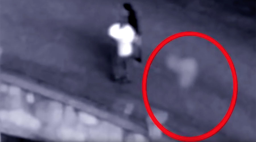 You'll never walk alone: CCTV captures 'ghost' alongside couple (VIDEO, POLL)