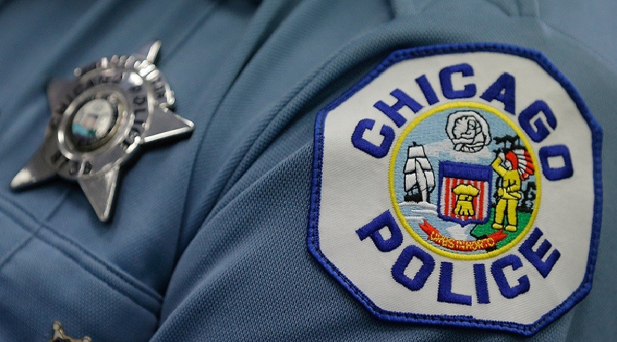 Off-duty Chicago officer stripped of powers after fatally shooting unarmed Hispanic man