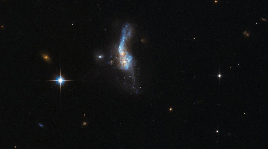 When galaxies collide: Moments of 'doom' captured majestically by Hubble (IMAGE)