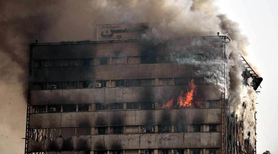'Like a horror movie': at least 20 feared dead after blaze topples Tehran's oldest high-rise