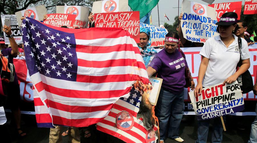 'Dump Trump': Filipinos gather to burn US flag, throw Trump photos into rubbish bins (PHOTOS)