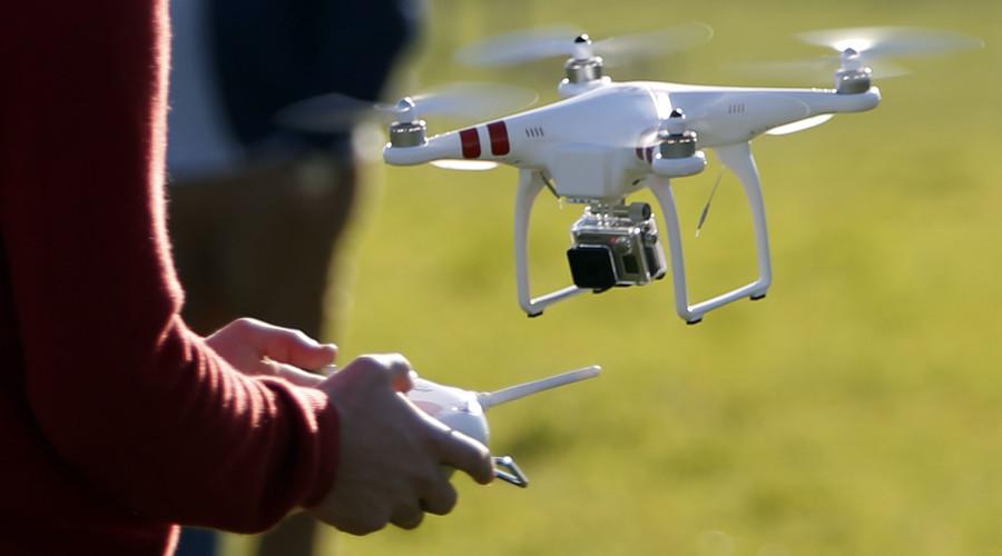 Close call: Passenger plane & drone narrowly avoid collision over UK school