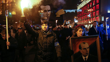 Activists of the Svoboda (Freedom) Ukrainian nationalist party hold flrares and torches as they take part in a rally to mark the 108th birth anniversary of Stepan Bandera, one of the founders of the Organization of Ukrainian Nationalists (OUN), in Kiev, Ukraine, January 1, 2017. © Valentyn Ogirenko