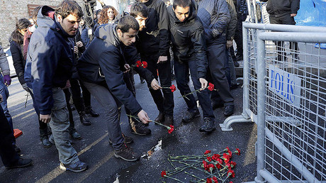 Men lay flowers outisde the Reina nightclub by the Bosphorus, which was attacked by a gunman, in Istanbul, Turkey, January 1, 2017. © Umit Bektas