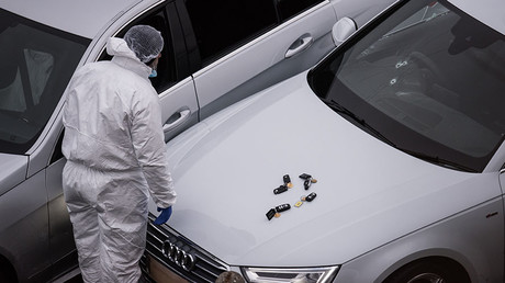 Bullet holes are seen in the windscreen of an Audi car as a British police forensics officer inspects the scene of an incident, which resulted in a West Yorkshire police officer shooting a suspect, at the Ainley Top junction of the M62 motorway near Huddersfield, England on January 3, 2017. © AFP
