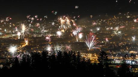 FILE PHOTO: Fireworks explode over the city of Innsbruck during New Year celebrations © Dominic Ebenbichler