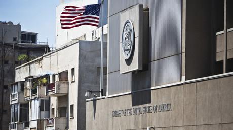 A flag flutters outside the U.S. embassy in Tel Aviv © Nur Elias